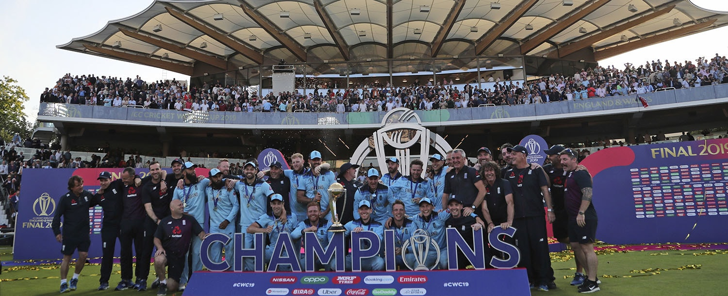England's cricketers celebrate with the trophy after winning the Cricket World Cup final match between England and New Zealand at Lord's cricket ground in London, England, Sunday, July 14, 2019. England won the Cricket World Cup for the first time in extraordinary circumstances, beating New Zealand by a tiebreaker of boundaries scored after the match was tied after regulation play and then the first Super Over in the tournament's history. (AP Photo/Aijaz Rahi) — Copyright 2019 The Associated Press. All rights reserved.