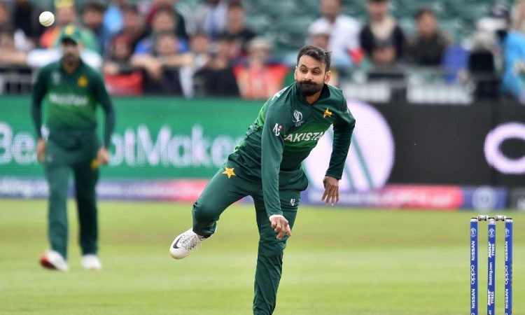 Mohammad Hafeez bowls during the 2019 Cricket World Cup warm up match between Pakistan and Afghanistan. — AFP
