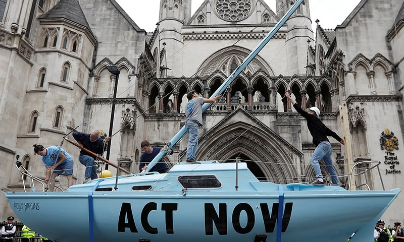 Activists block United Kingdom roads in new climate-change protests