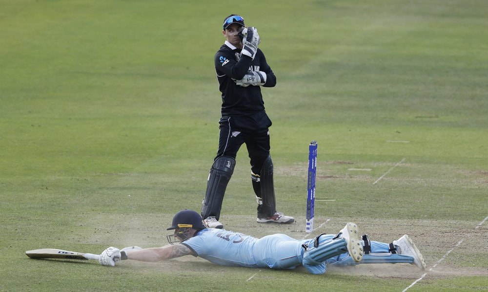 England's Ben Stokes dives in to make his ground and get a 6 from overthrows during the Cricket World Cup final match between England and New Zealand at Lord's cricket ground in London, on Sunday, July 14. — AP