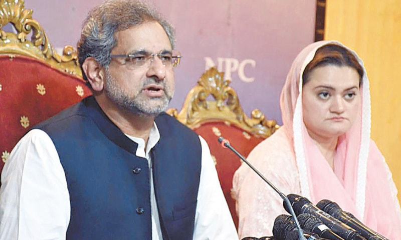 ISLAMABAD: Pakistan Muslim League-Nawaz leader Shahid Khaqan Abbasi (left) and Special Assistant to Prime Minister on Accountability Shahzad Akbar address separate press conferences on Monday.—Tanveer Shahzad