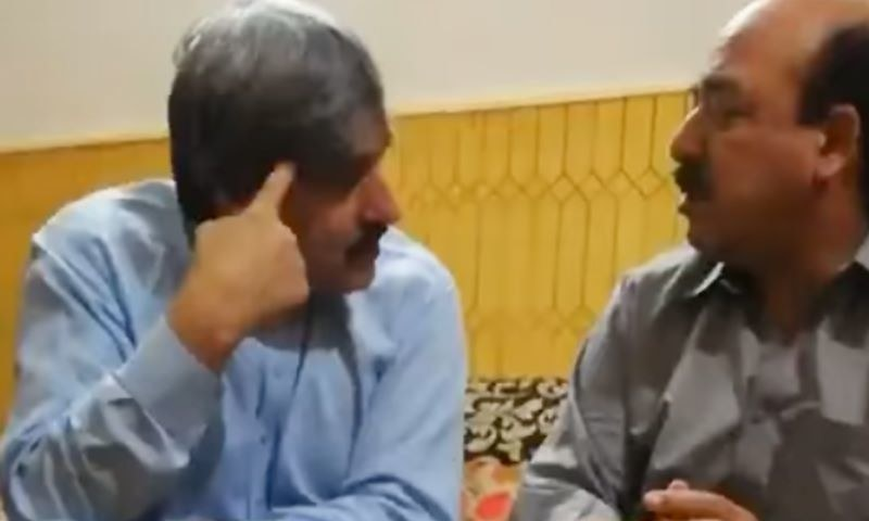 A screengrab from a video shown by PML-N leader Maryam Nawaz at a press conference shows judge Arshad Malik (R) in conversation with PML-N supporter Nasir Butt (L). — DawnNewsTV