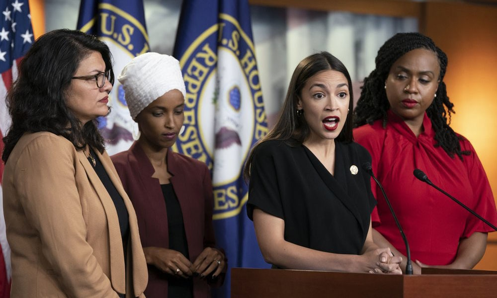 US Rep Alexandria Ocasio-Cortez, D-NY, speaks as, from left, Rep Rashida Tlaib, D-Mich, Rep Ilhan Omar, D-Minn, and Rep. Ayanna Pressley, D-Mass, listen during a news conference at the Capitol in Washington. — AP