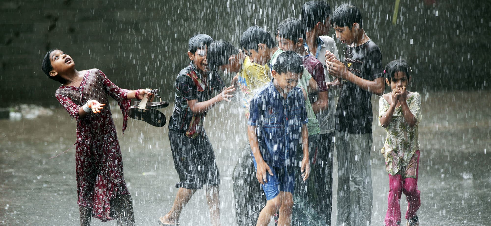 Children play in the rain in Lahore, Pakistan July 16, 2019. REUTERS/Mohsin Raza