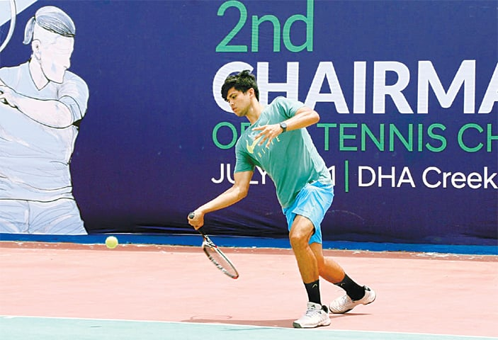 ASAD Khan plays a return against Ahmed Choudhary during their first-round match at the CJCSC Open Tennis Championship on Tuesday.—INP