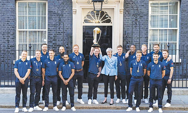 LONDON: Members of England's World Cup-winning squad alongside Britain's Prime Minister Theresa May pose for a group photo with the trophy outside 10 Downing Street.—AFP