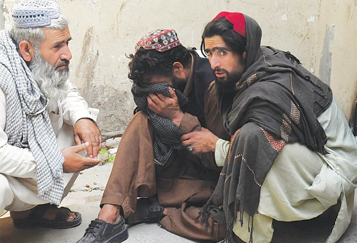 Quetta: Men at a hospital on Tuesday comfort a relative of a worker following his death in a coal mine accident.—AFP