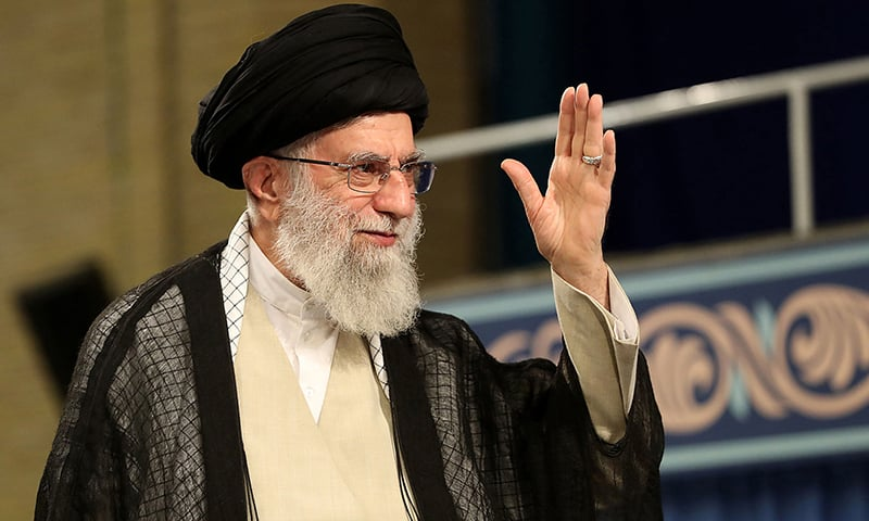 A handout picture provided by the office of Iran's supreme leader Ayatollah Ali Khamenei shows him waving to the crowd during a ceremony attended by Iranian clerics in the Iranian capital Tehran, on July 16. — AFP photo/ HO/ KHAMENEI.IR