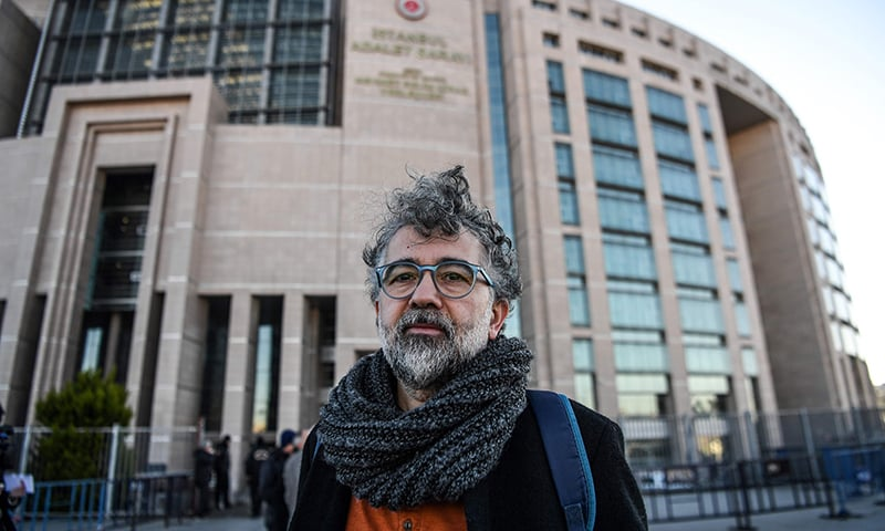 In this file photo taken on January 18, Turkish-French journalist Erol Onderoglu, representative of international rights group Reporters Without Borders (RSF), is pictured in front of Istanbul's courthouse building, where the trial of five journalists from opposition daily Sozcu was to open. — AFP