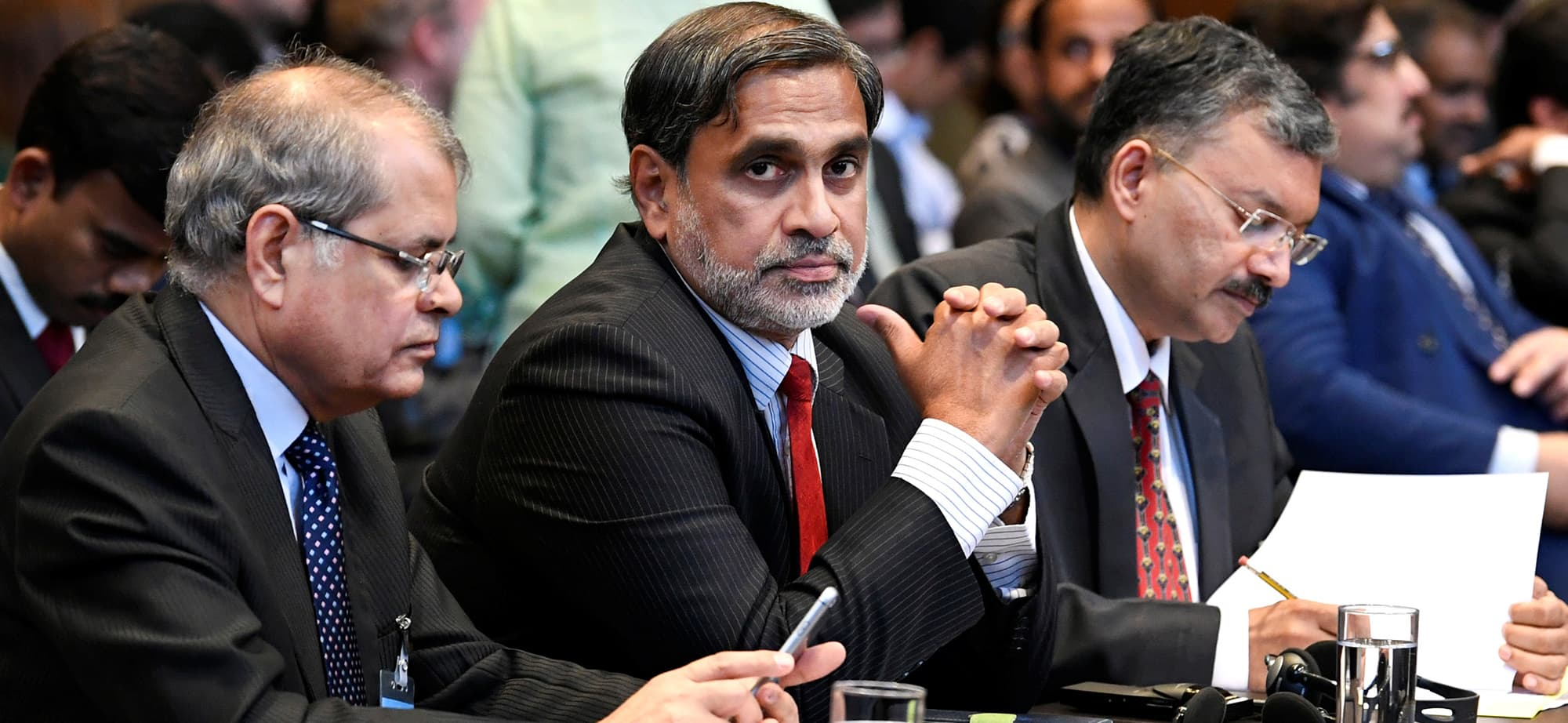 Vishnu Dutt Sharma, additional secretary, Ministry of External Affairs, Venu Rajamony, Ambassador of India to the Netherlands and Deepak Mittal, joint secretary of Indian Ministry of External Affairs are seen at the International Court of Justice before the issue of a verdict in the case of Indian national Kulbhushan Jadhav, who was sentenced to death by Pakistan in 2017, in The Hague, Netherlands July 17, 2019. REUTERS/Piroschka van De Wouw