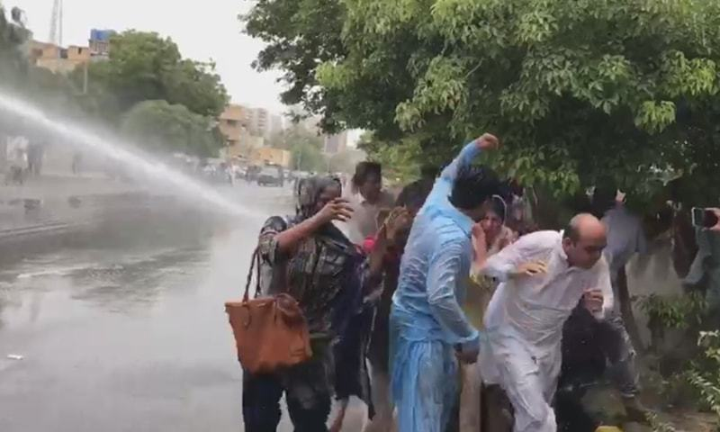 Chaos ensued outside CM House when police resorted to the use of water cannons to disperse protesters. — DawnNewsTV screengrab