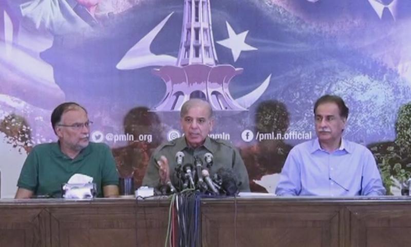 PML-N President Shehbaz Sharif, accompanied by party leaders Ayaz Sadiq and Ahsan Iqbal, addresses a press conference on Thursday.— DawnNewsTV