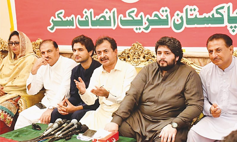 PTI leader Haleem Adil Sheikh speaks at the press conference.—Dawn