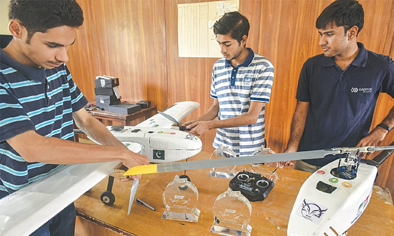 STUDENTS display their award-winning drones on Thursday.—White Star