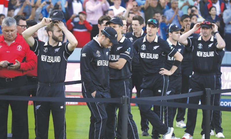 New Zealand's captain Kane Williamson (left) stands with his team-mates as he waits for the trophy presentation after losing the Cricket World Cup final