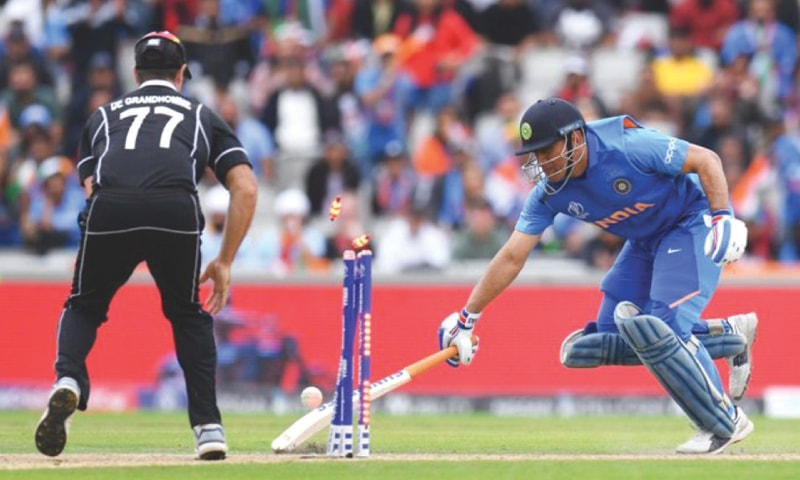 Lucky enough to get a direct hit by Martin Guptill, M.S. Dhoni is run-out in the semi-final