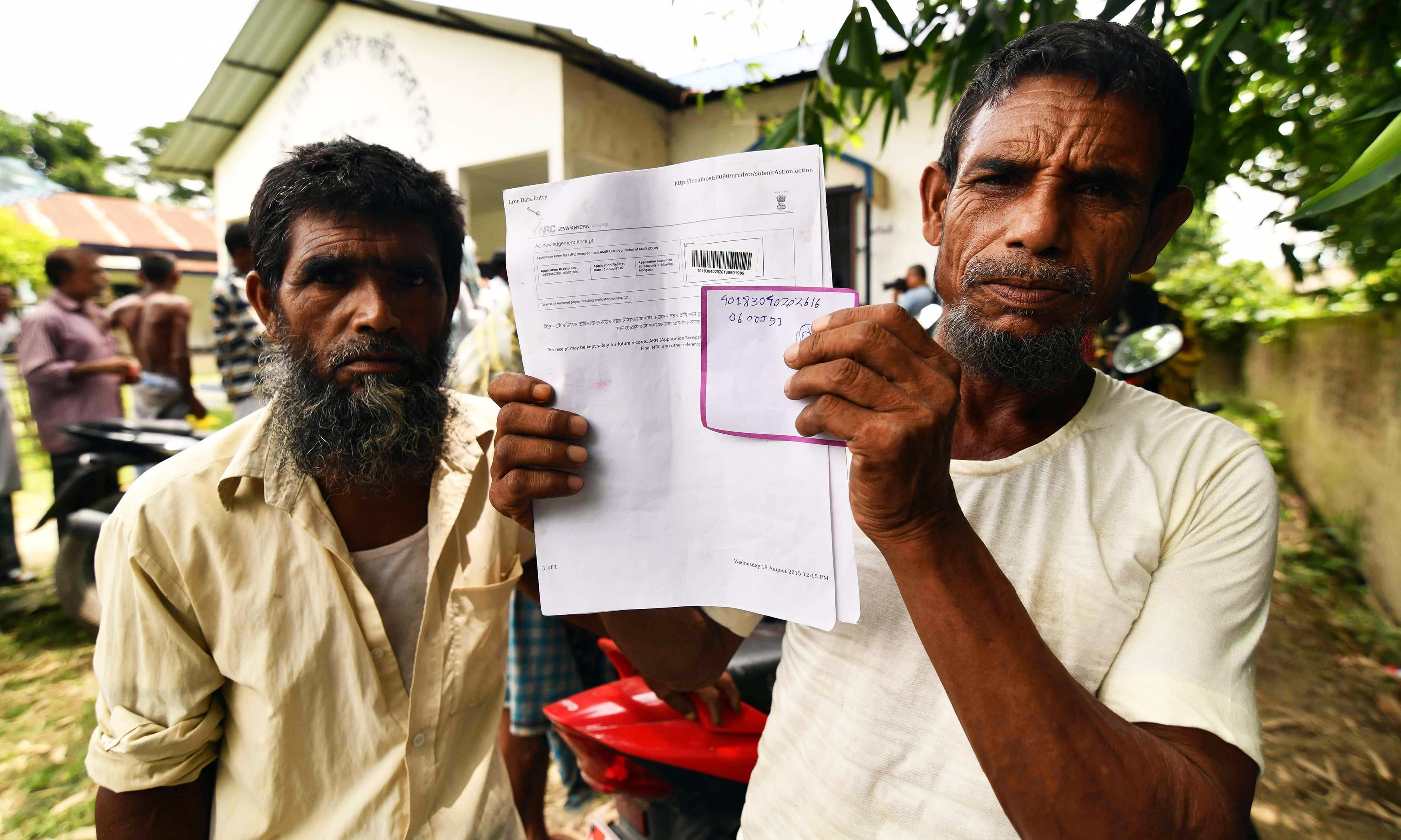A resident holds documents on his way to check their names on the final list of National Register of Citizens (NRC) at a NRC Sewa Kendra (NSK) in Kuranibori village in Morigoan district on July 30, 2018. — AFP