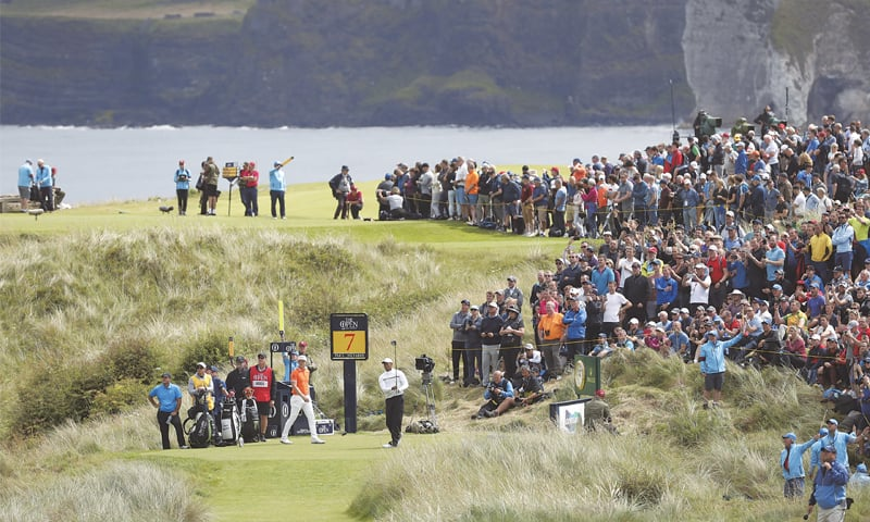 PORTRUSH: Tiger Woods of the US tees off the seventh hole during the second round of the British Open on Friday.—AP