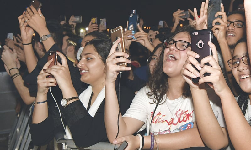 JEDDAH: Saudi women film and wave during the concert.—AP