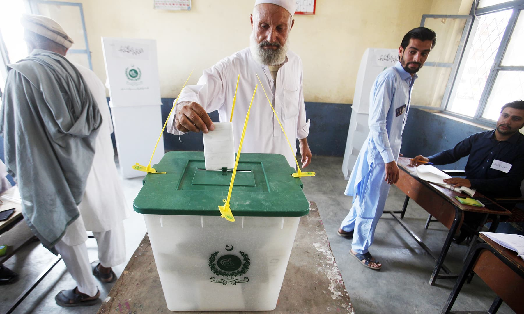 A tribesman casts his vote during an election for provincial seats in Jamrud, a town of Khyber district. — AP
