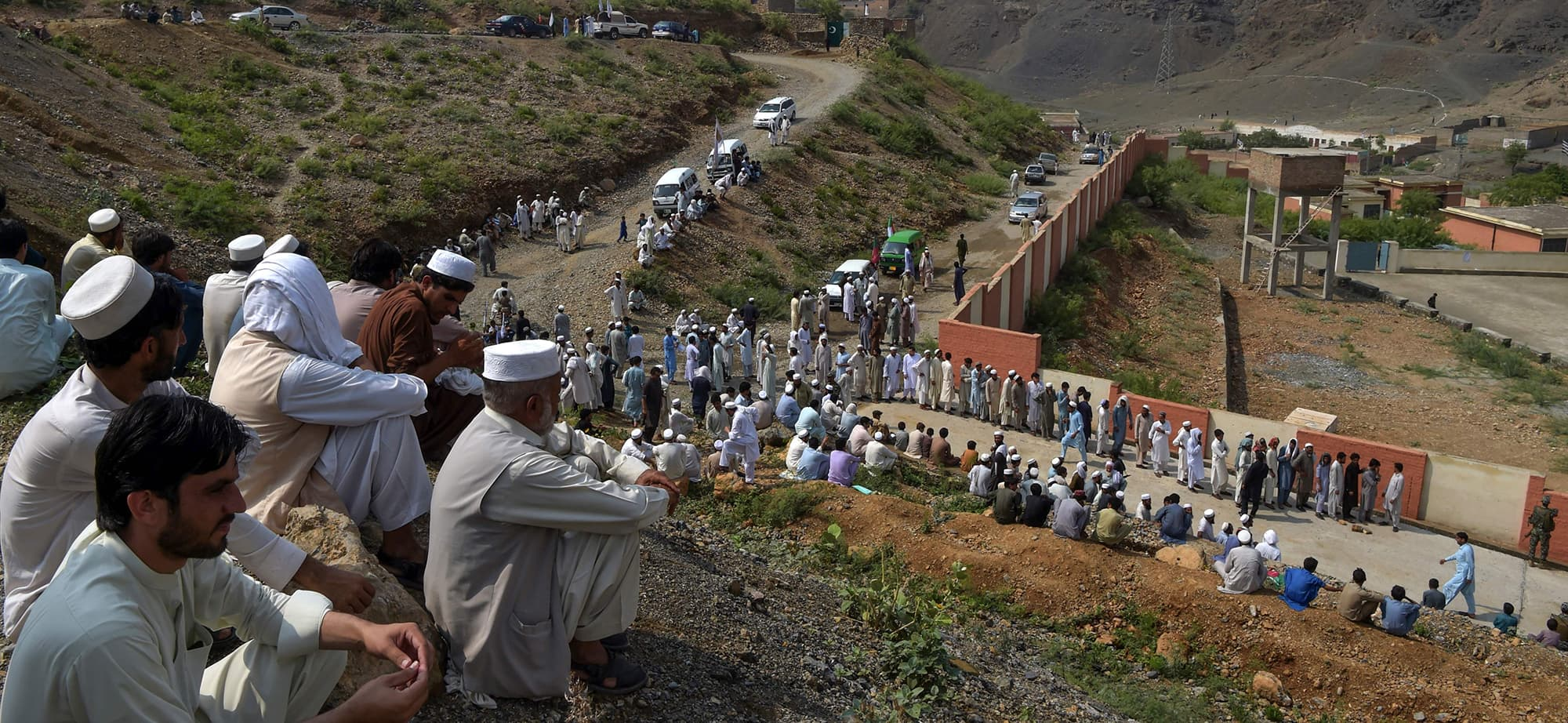 Tribesmen line up to cast their vote outside a polling station for the first provincial elections in Jamrud, a town of the Khyber Pakhtunkhwa province on July 20, 2019. - Pakistan's tribal areas held their first ever provincial elections on July 20 amid high security, a key step bringing the northwestern region into the political mainstream after years of turmoil fuelled by militancy. (Photo by ABDUL MAJEED / AFP) — AFP or licensors