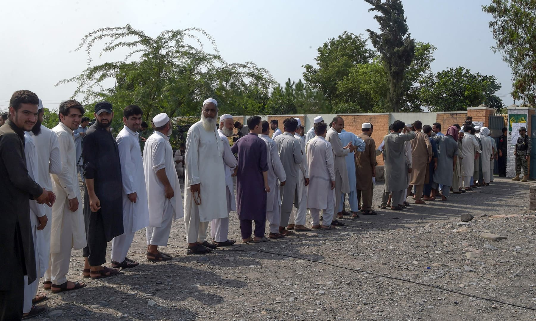Voters line up outside a polling station for the first provincial elections in Jamrud. — AFP