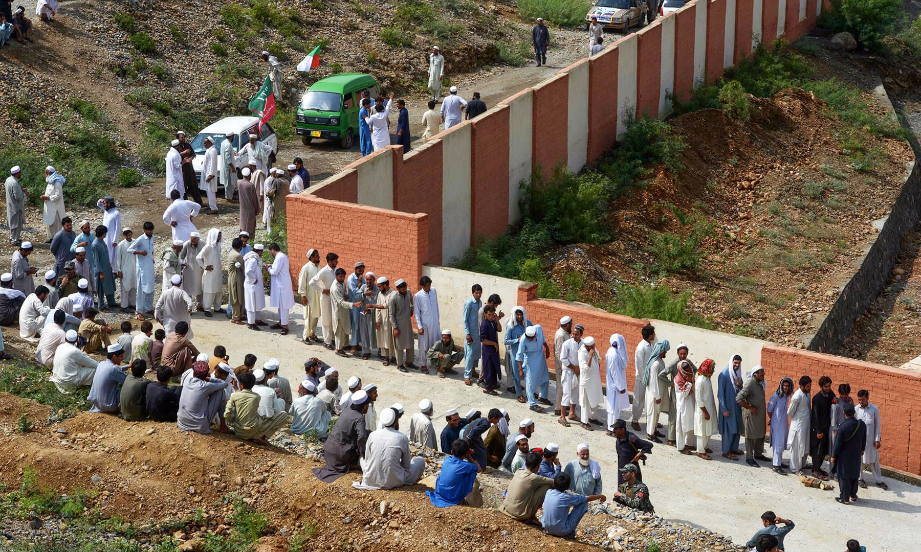 Tribesmen seen queued up to cast their vote outside a polling station for the first provincial elections in Jamrud. — AFP