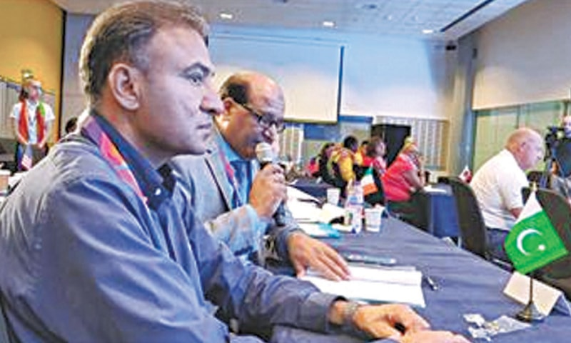 LIVERPOOL: PNF president Mudassar Arain reads out a report of Pakistan's netball activities in 2018-19 as PNF chairman Zafar Iqbal Awan looks on at the INF Congress  on Friday.