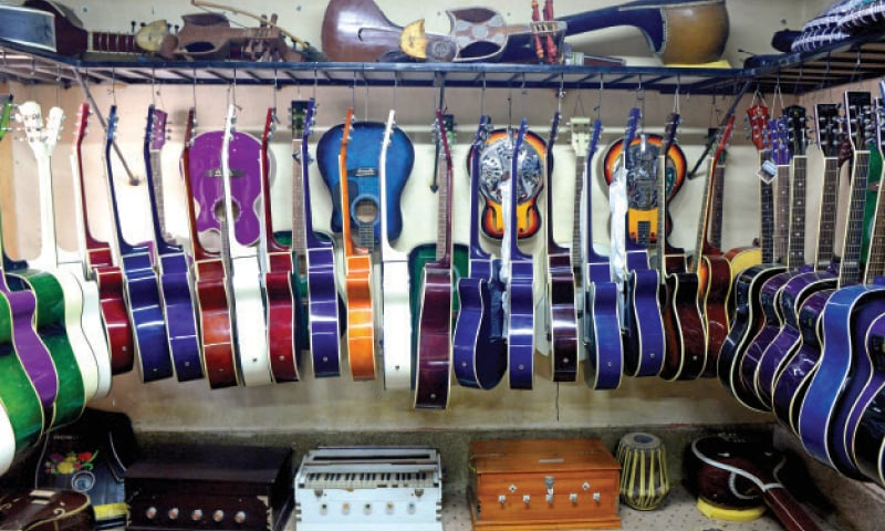 A wide selection of guitars on display at a shop in Sur Gali.