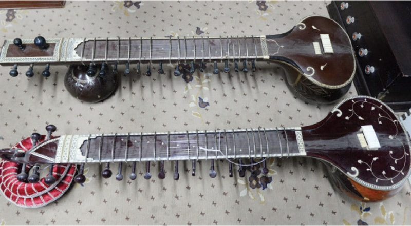 Sitars, a traditional South Asian instrument, are made and repaired at shops in the market.
