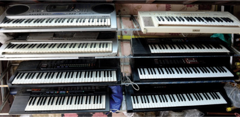 Pianos on display at a shop that specialises in manufacturing and repairing modern instruments. — Photos by Mohammad Asim