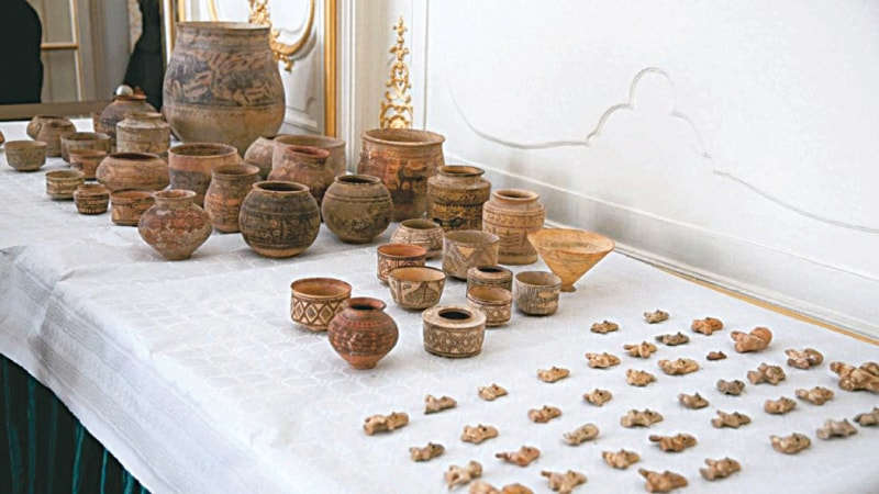 A number of returned archaeological objects displayed on a table