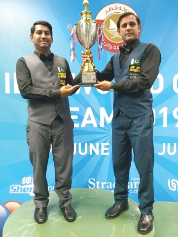 Asjad Iqbal (L) and Mohammad Bilal after winning the IBSF World Team Cup in Doha
