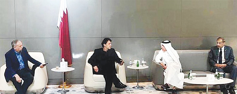 DOHA: Prime Minister Imran Khan speaks to Qatar Airways CEO Akbar Albaker during a meeting while on transit to Washington on Saturday. The prime minister opted to fly by a commercial flight to save public money. This is the first visit of the prime minister to the US after assuming office.— APP