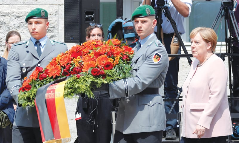 Berlin: Chancellor Angela Merkel takes part in a wreath-laying during a ceremony to mark the 75th anniversary at the site where a group of officers led by Claus Schenk Graf von Stauffenberg was shot after their failed July 20, 1944 attempt on the life of Adolf Hitler. — Reuters