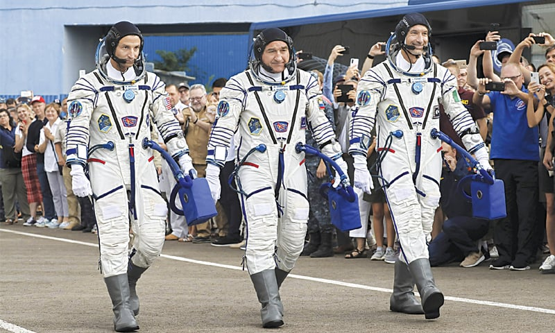 From left: US astronaut Andrew Morgan, Russian cosmonaut Alexander Skvortsov and Italian astronaut Luca Parmitano walk prior the launch of space ship on Saturday. — AP