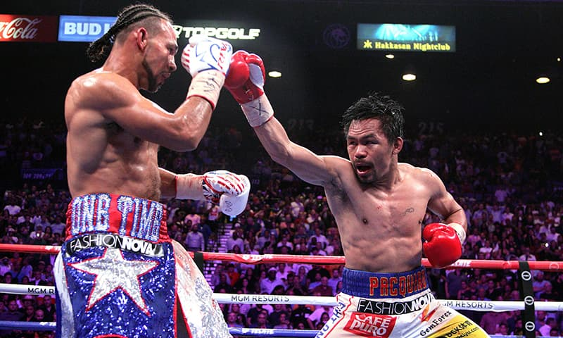 Filipino boxer Manny Pacquiao (R) and US boxer Keith Thurman during their WBA super world welterweight title fight at the MGM Grand Garden Arena on July 20, 2019 in Las Vegas, Nevada. — AFP