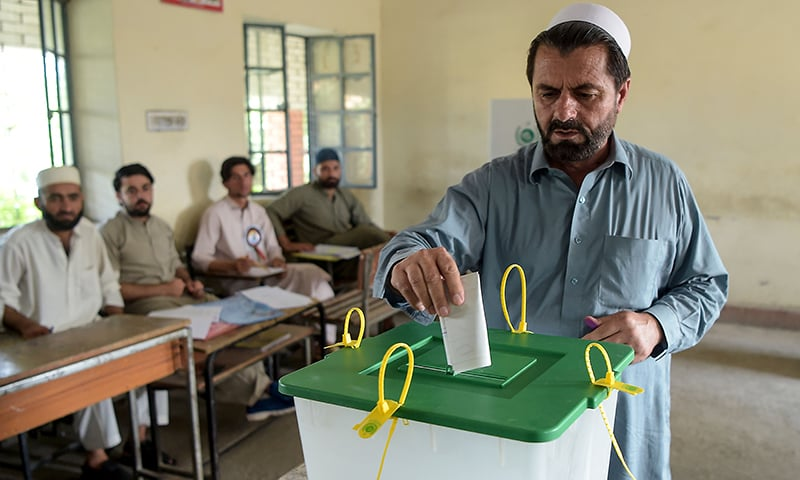 A resident of the tribal areas casts his vote in a polling station for the first provincial elections in Jamrud, a town of the Khyber Pakhtunkhwa province on July 20. — AFP