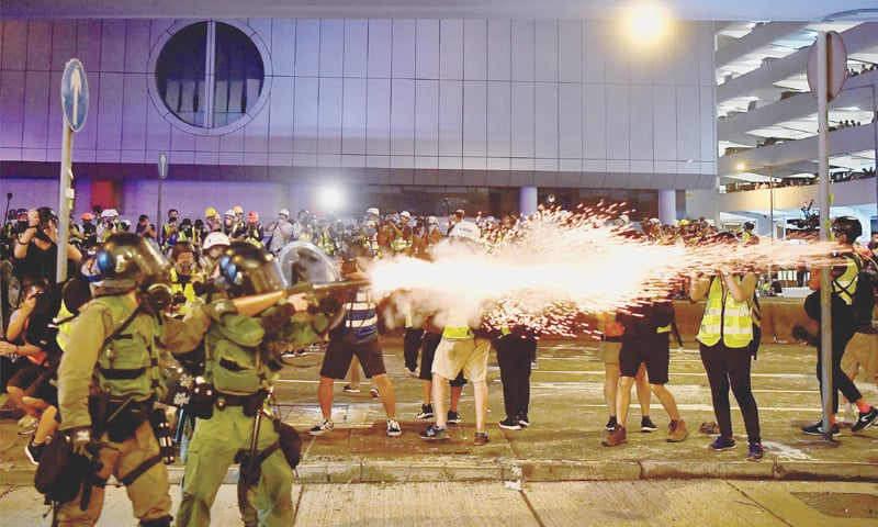 Hong Kong returns to chaos as police fire rubber bullets at protesters