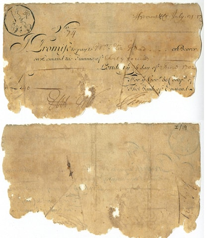 LONDON: An undated handout photo released by the Bank of England Museum shows a note for £40, issued to Elizabeth Head in 1702, one of the oldest notes in the collection.—AFP