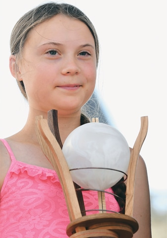 Caen (France): Swedish climate activist Greta Thunberg smiles as she receives the prize on Sunday.—AFP