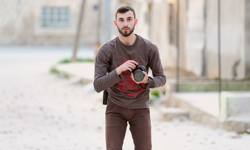 An image taken on Feb 25 shows Syrian citizen journalist Anas al Dyab posing for a picture in the town of Khan Shaykhun.—AFP