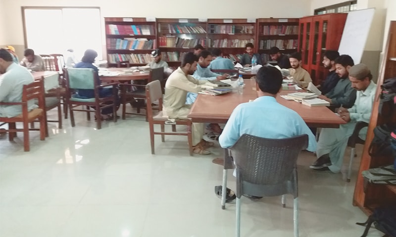 MEMBERS reading at the hospital-turned-library on Sariab Road.—Dawn