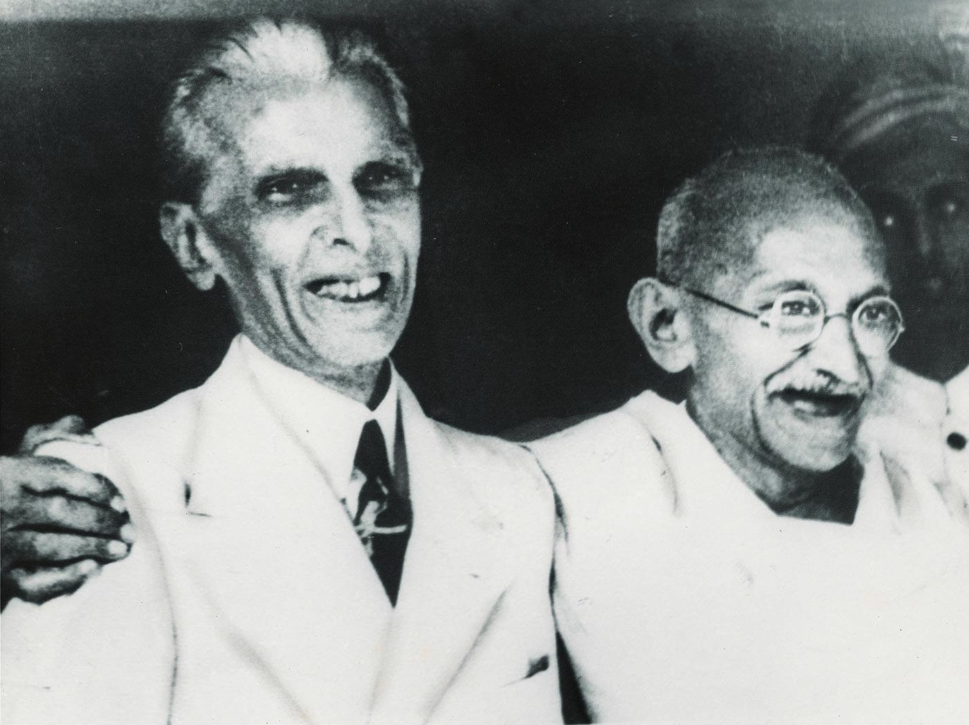 The Quaid-i-Azam, Mohammad Ali Jinnah and Mahatma Gandhi smile during the Jinnah-Gandhi talks. — Courtesy National Archives Islamabad