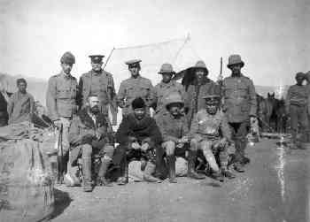 Francis Younghusband and team on a 'military expedition' to Tibet in January 1904. Younghusband is seated in the centre of the photograph, wearing the fur coat and hat.