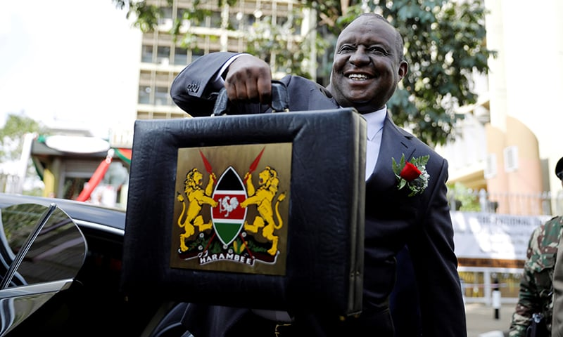 This file photo shows Kenya's Cabinet Secretary for National Treasury (Finance Minister) Henry Rotich holding up a briefcase containing the Government Budget for the 2019/20 fiscal year in Nairobi, Kenya on June 13, 2019. — Reuters