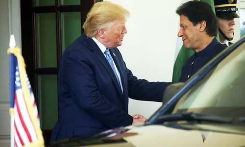 US President Donald Trump greets Prime Minister Imran Khan at the White House in Washington, US, July 22. — Reuters