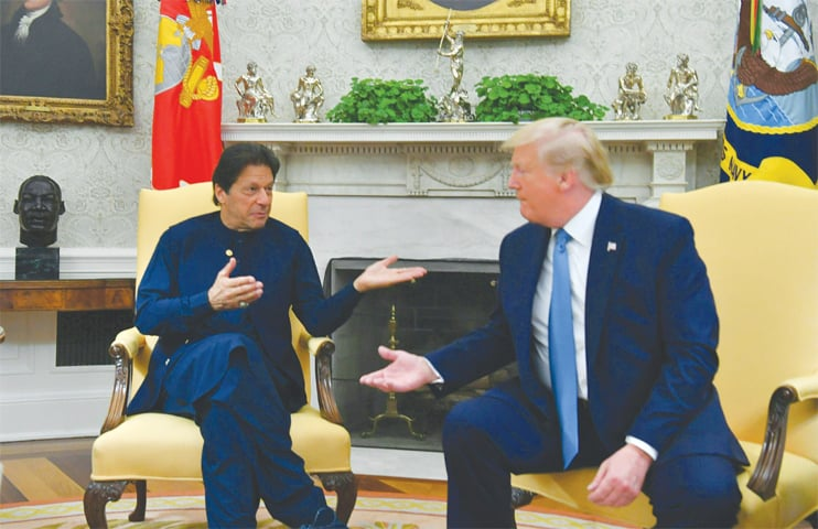 PRIME Minister Imran Khan and US President Donald Trump in conversation during a meeting at the Oval Office of the White House on Monday.—AFP