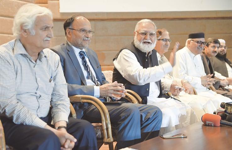 Opposition leaders Akram Durrani, Ahsan Iqbal, Farhatullah Babar, Nayyer Bokhari, Mian Iftikhar and Owais Noorani at a press conference on Monday. —Tanveer Shahzad / White Star