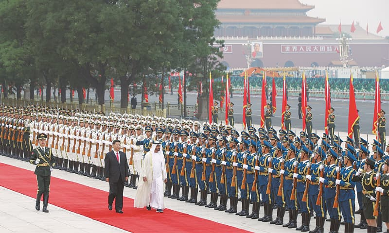 Beijing: Abu Dhabi's Crown Prince Sheikh Mohammed bin Zayed Al Nahyan (right) and Chinese President Xi Jinping review a guard of honour during a welcome ceremony at the Great Hall of the People on Monday.—AP